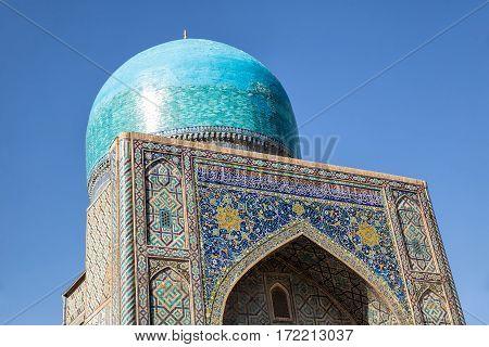 The dome of the mosque Tilya Kari madrassah on Registan Square Samarkand Uzbekistan