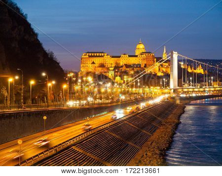 Illuminated Royal Buda Castle above Danube River by night in Budapest, Hungary, Europe. UNESCO World Heritage Site.
