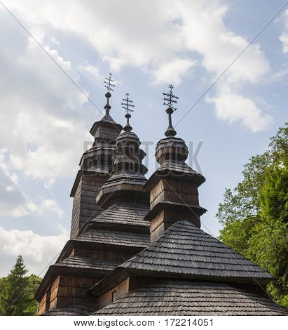 Ancient wooden Ukrainian church (XVIII century) from the Carpathians in the open-air Museum of Folk Architecture near Kyiv.