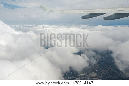 Sydney, Australia - Oct 29, 2016: Flying above the clouds, moments after plane left Sydney Kingsford-Smith International Airport.