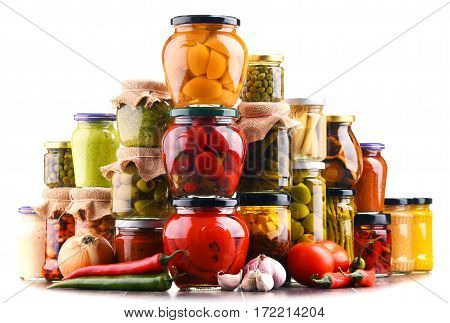 Jars With Variety Of Pickled Vegetables  Isolated On White