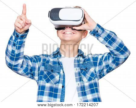 Happy teen boy wearing virtual reality goggles watching movies or playing video games, isolated on white background. Cheerful smiling looking in VR glasses and gesturing with his hands. Child experiencing virtual reality.