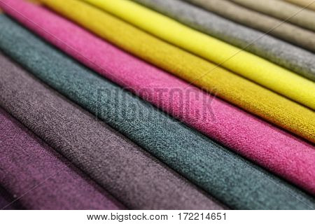 the samples of multi-colored upholstery fabrics vertical stripes