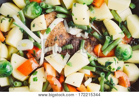 Vegetable Mix In A Frying Pan On A Dark Background