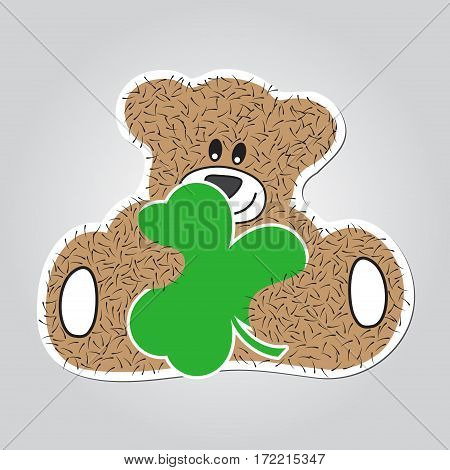 Sticker cartoon illustration - sitting and smiling brown furry bear with green clover in the hands. White outline with shadow.