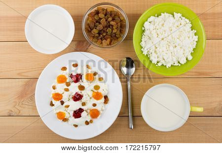 White Plate With Cottage Cheese, Raisins And Jam On Table