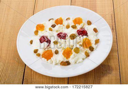 Cottage Cheese, Yogurt, Raisins, Peach Jam And Raspberry Jam