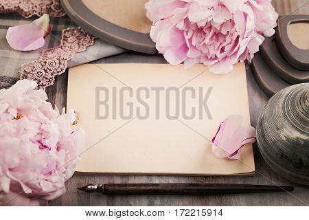 Nostalgic Background with Paper Spring Flowers and Pen on Wooden Deck