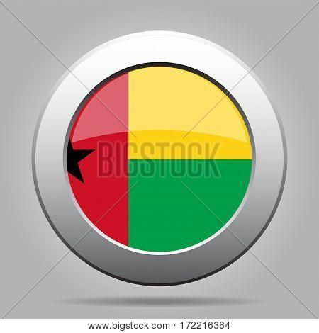 National flag of Guinea-Bissau. Shiny metal gray round button with shadow.