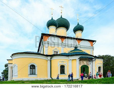 UGLICH RUSSIA - JULY 19 2016: Unidentified people go to Saviour Transfiguration Cathedral Uglich Russia