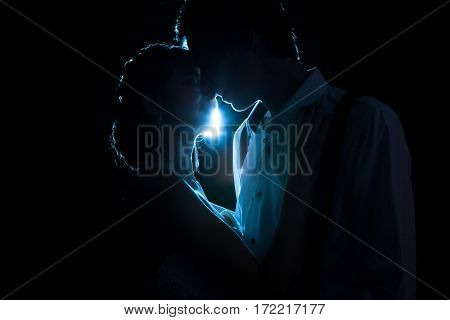 Loving Couple Backlit With A Blue Light