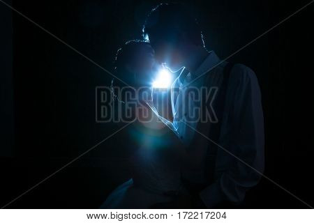 Couple Backlit With A Blue Light