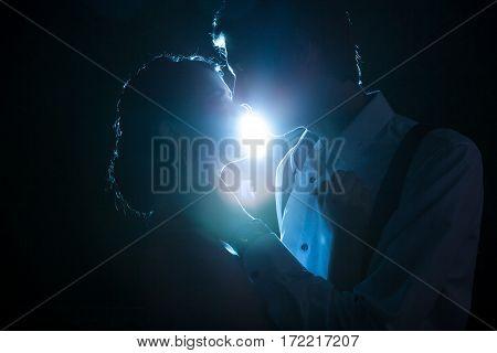 Romantic Couple Backlit With A Blue Light