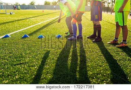 Soccer Football Training Session for Kids. Boys Training Football on the Pitch. Soccer Stadium in the Background