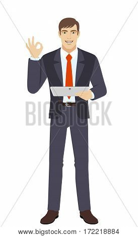 OK! Smiling businessman show a okay hand sign and holding digital tablet PC. Full length portrait of businessman in a flat style. Vector illustration.