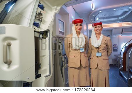 HONG KONG - CIRCA NOVEMBER, 2016: Emirates crew members on board of A380. Emirates is one of two flag carriers of the UAE along with Etihad Airways and is based in Dubai.