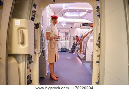 DUBAI, UAE - CIRCA NOVEMBER 2016: Emirates crew member on board of A380. Emirates is one of two flag carriers of the UAE along with Etihad Airways and is based in Dubai.