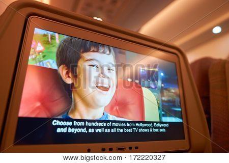 DUBAI, UAE - CIRCA NOVEMBER 2016: close up shot of a seat-back screen inside the cabin of a Emirates A380.