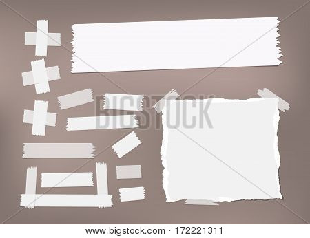 Ripped white notebook, copybook, note paper, sticky, adhesive masking tape stuck on brown background.