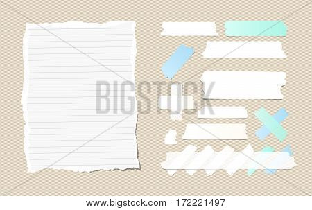 Ripped ruled white notebook, copybook, note paper, sticky, adhesive masking tape stuck on squared pattern.