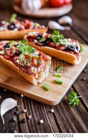 Baguette Pizza With Bacon, Salami, Cheese And Vegetable