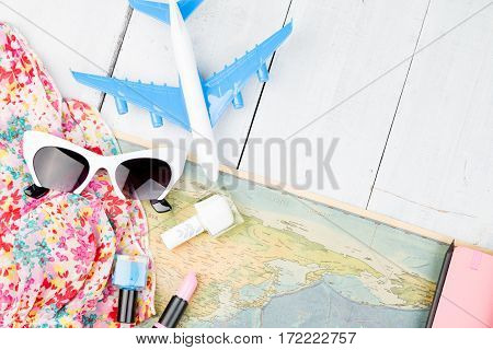 Plane, Map, Woman Accessories On White Wooden Table