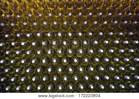 Stacked up white wine bottles in wine shop