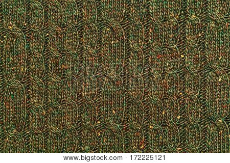 Background texture of knitted sweaters. Green abstract background with pattern. Textile closeup top view