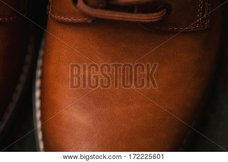 leather shoes closeup. Background texture of leather, nubuck. Top view, close-up shooting