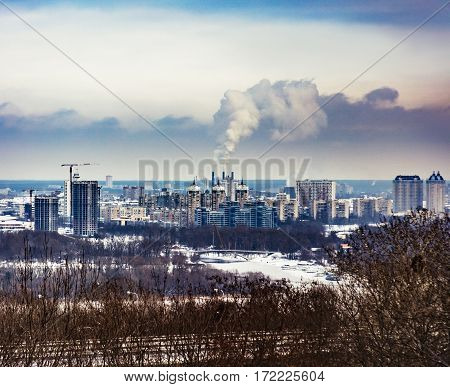 General city landscape with poisoned emissions from plant. Kiev general cityscape , with trees on the first plan. Left coast of Kiev city