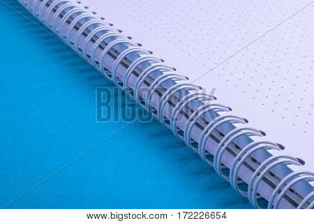 Notebook, blue background texture, empty space for text