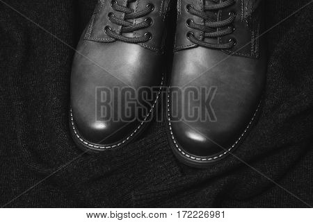 men's black boots. black and white photography