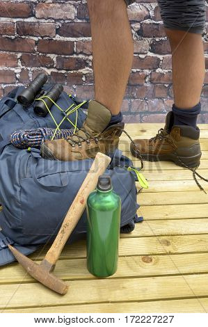 Hiking equipment rucksack boots and backpack. Concept for family hiking. Colorful background.