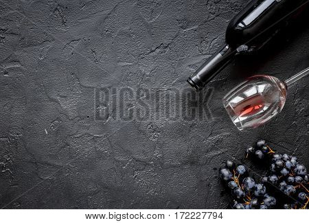 Glasses of red wine and bottle on dark stone background top view mockup