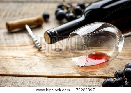 Wine set with glass, bottle and fresh grape on wooden desk background