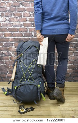 Woman with Hiking equipment rucksack boots and backpack. Concept for family hiking. Colorful background.