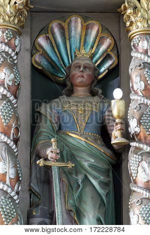 KRAPINA, CROATIA - MAY 15: Saint Barbara statue at the altar in the church of Saint Catherine of Alexandria in Krapina, Croatia on May 15, 2011.