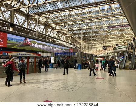 LONDON - FEBRUARY 17, 2017: Passengers and pedestrians inside London Waterloo Railway Station in Waterloo, Lambeth, London, UK. Local and suburban services are operated by South West Trains.
