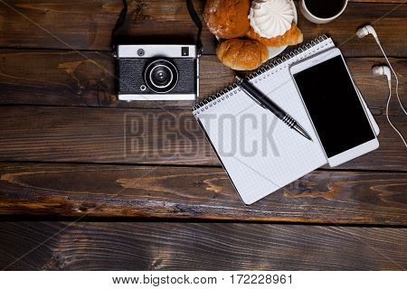 Camera With Headphones With Croissants And Coffee Next To Notebook