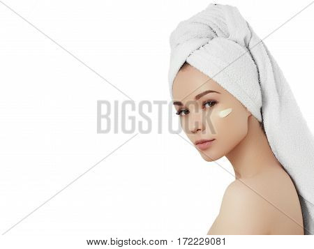 Spa Girl. Beautiful Young Woman After Bath Touching Her Face With Cosmetic Cream. Woman Beauty Face