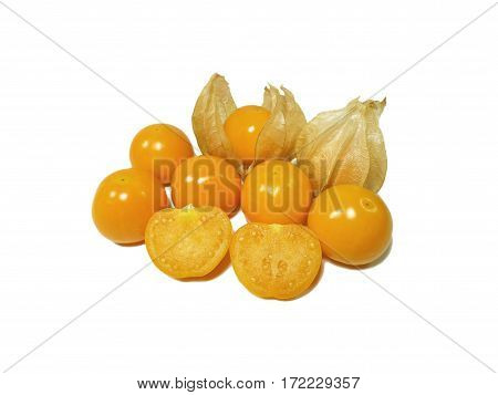 Bunch of vibrant yellow ripe Cape gooseberries, some with calyx, some cut in half isolated on white background