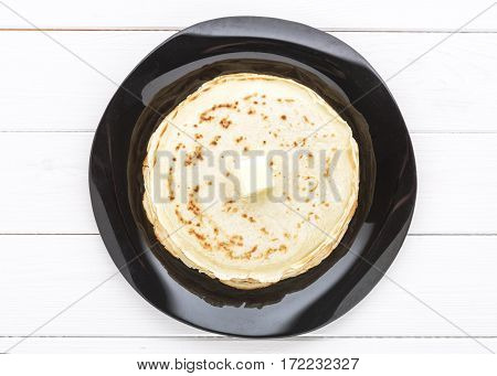 Close-up Pancakes With Butter In  Platter On White Background. Top View