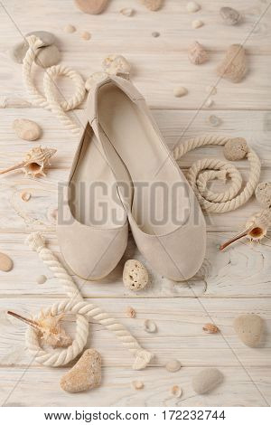 Women's summer shoes for beach holidays. Selective focus.