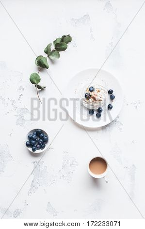 Breakfast with cup of coffee sweet dessert blueberry. Flat lay top view