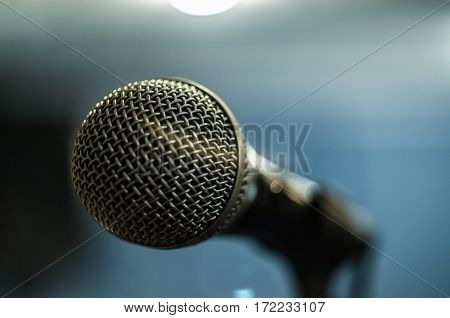 Close up dynamic microphone in recording studio