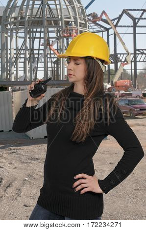 Construction Worker with a hard hat and walkie talkie