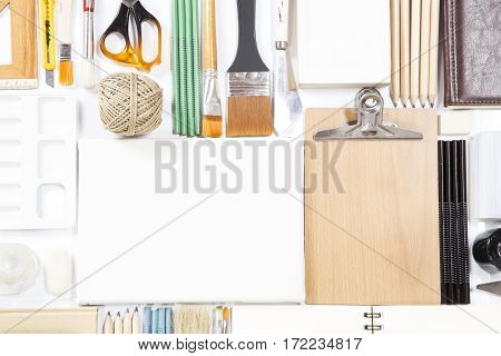 Various painting and stationary equipment as background