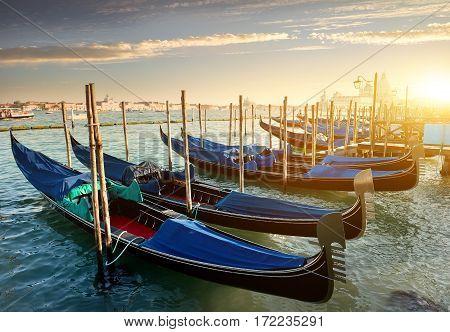 Venice with gondolas on Grand Canal against San Giorgio Maggiore church in Venice, Italy