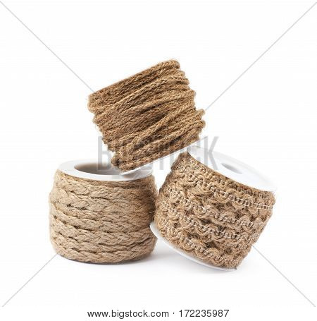 Pile of decorational rope string bobbins isolated over the white background