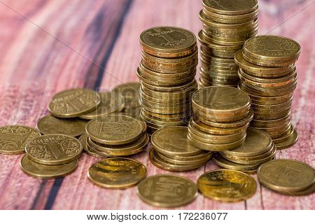 Stack Of Coins On Wooden Table  .
